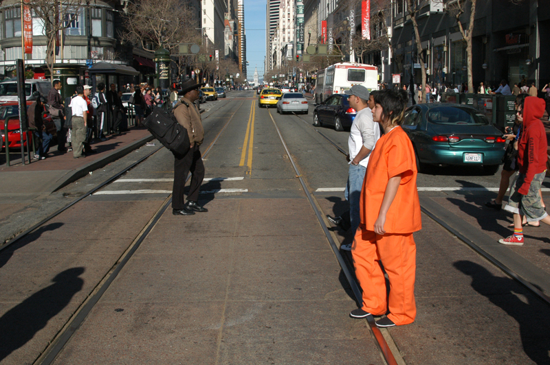 """The Inmate"" walking across Powell Street, San Francisco - USA"